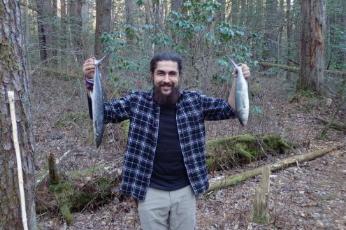 A friend of mine adventurously fillets a whole fish on an overnight trip